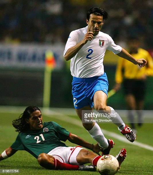 Christian Panucci of Italy is tackled by Jesus Arellano of Mexico during the FIFA World Cup Korea/Japan Group G match between Mexico and Italy at the...