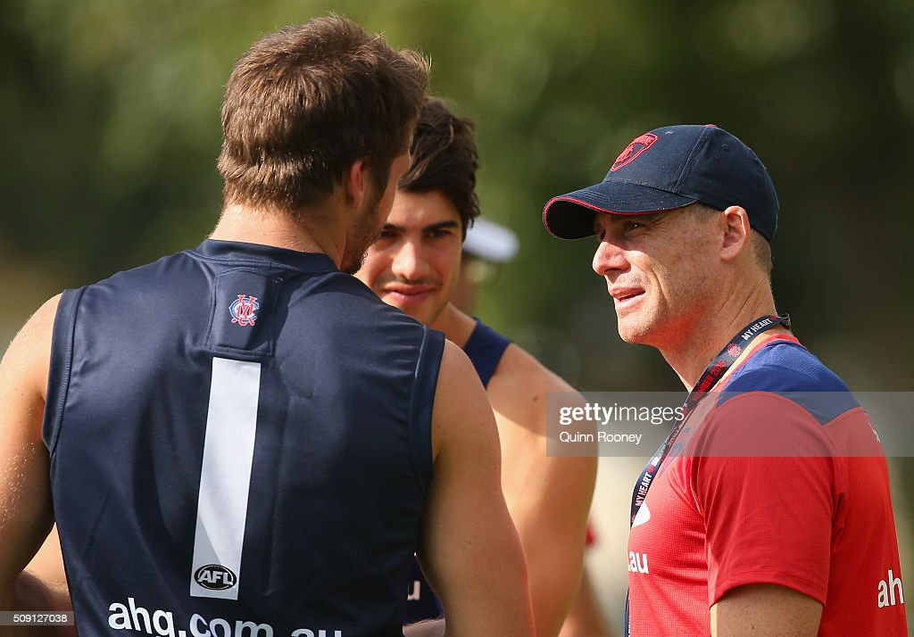 Christian Petracca and Jesse Hogan of the Demons speak to assistant coach <a gi-track='captionPersonalityLinkClicked' href=/galleries/search?phrase=Simon+Goodwin&family=editorial&specificpeople=224540 ng-click='$event.stopPropagation()'>Simon Goodwin</a> during a Melbourne Demons AFL pre-season training session at Gosch's Paddock on February 9, 2016 in Melbourne, Australia.