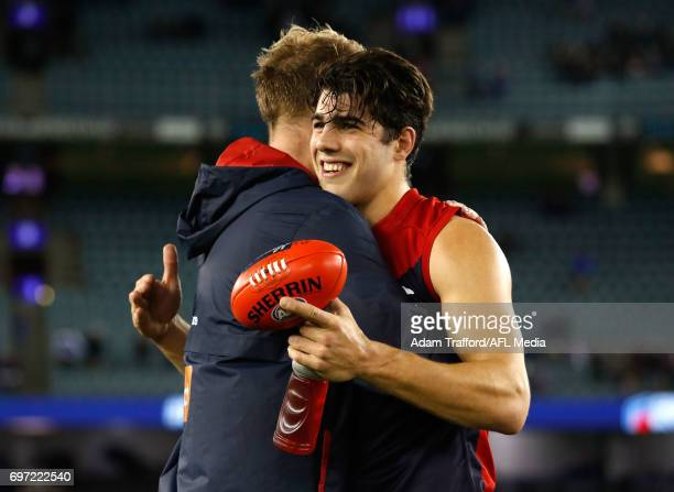 Christian Petracca celebrates with Jack Watts of the Demons of the Demons during the 2017 AFL round 13 match between the Western Bulldogs and the...