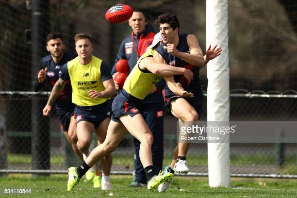 Christian Petracca hand passes during a Melbourne Demons AFL training session at Gosch's Paddock on August 18 2017 in Melbourne Australia