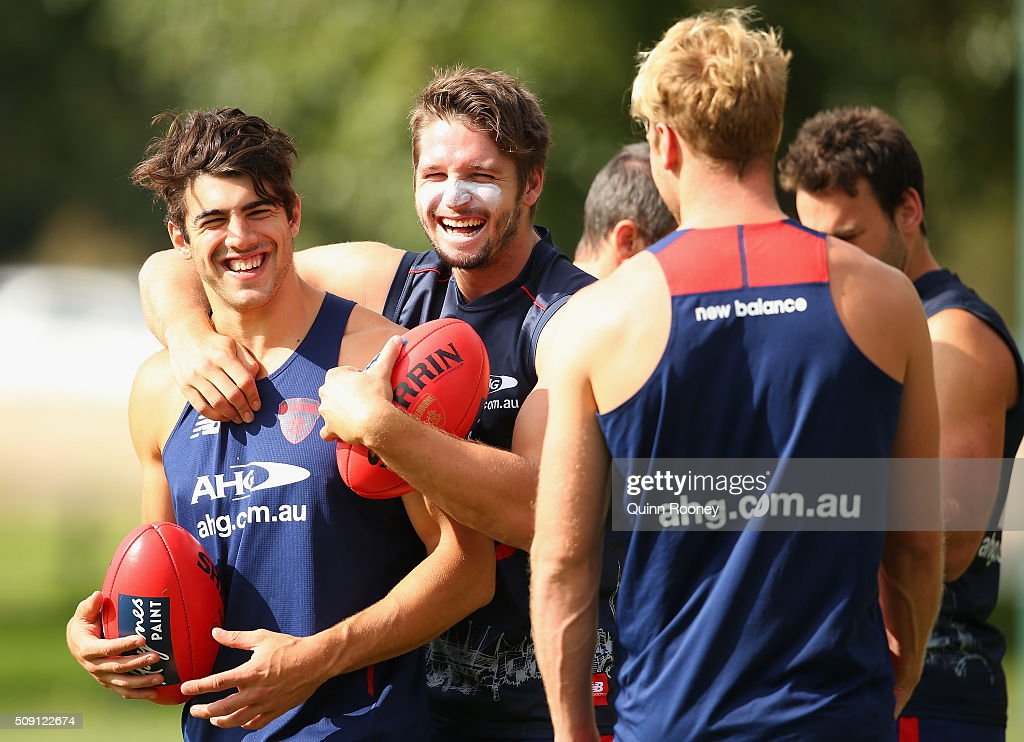 Christian Petracca, Jesse Hogan and Jack Watts of the Demons have a laugh during a Melbourne Demons AFL pre-season training session at Gosch's Paddock on February 9, 2016 in Melbourne, Australia.