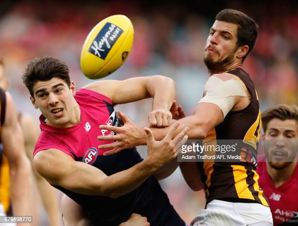Christian Petracca of the Demons and Ben Stratton of the Hawks compete for the ball during the 2017 AFL round 07 match between the Melbourne Demons...