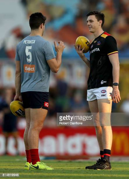Christian Petracca of the Demons and Jake Lever of the Crows talk during the warm up session prior to the round 17 AFL match between the Melbourne...