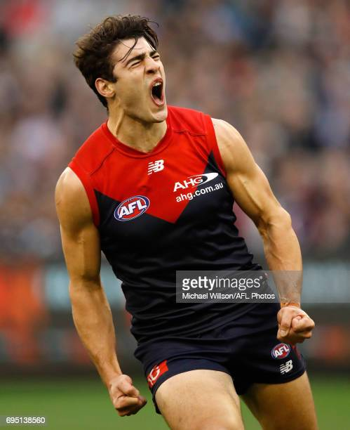 Christian Petracca of the Demons celebrates a goal during the 2017 AFL round 12 match between the Melbourne Demons and the Collingwood Magpies at...