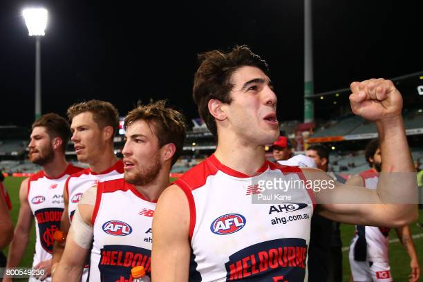 Christian Petracca of the Demons celebrates with supporters after winning the round 14 AFL match between the West Coast Eagles and the Melbourne...