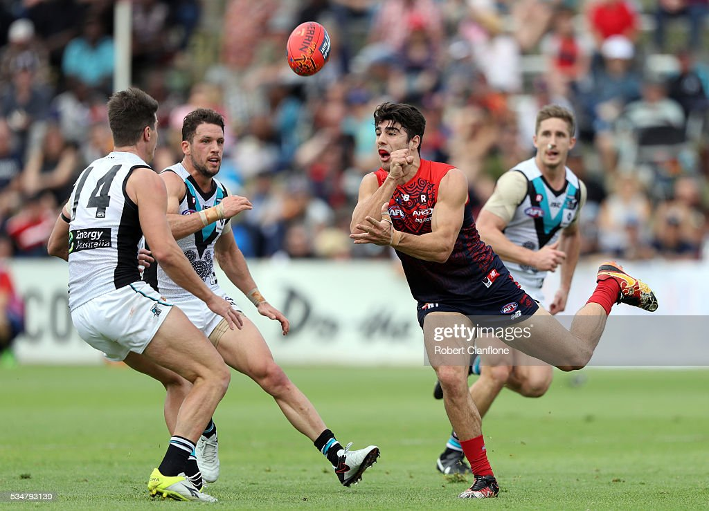 Christian Petracca of the Demons handballs during the round 10 AFL match between the Melbourne Demons and the Port Adelaide Power at Traeger Park on May 28, 2016 in Alice Springs, Australia.