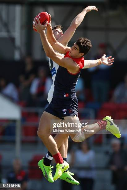 Christian Petracca of the Demons marks over Lachie Plowman of the Blues during the AFL 2017 JLT Community Series match between the Melbourne Demons...