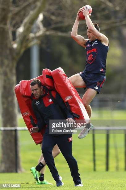 Christian Petracca takes a mark during a Melbourne Demons AFL training session at Gosch's Paddock on August 18 2017 in Melbourne Australia
