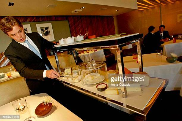 Christian Philippo serves cheese from the fancy cheese cart at Patina an elegant restaurant at the Walt Disney Concert Hall in Los Angeles on June 2...