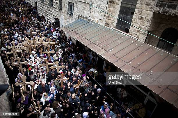 Christian pilgrims carry wooden crosses along the Via Dolorosa during the Good Friday procession on April 22 2011 in Jerusalem Israel Thousands of...