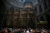 Christian pilgrims line up to enter the Tomb of Christ in the Church of the Holy Sepulchre on April 23 2016 ahead of the Orthodox Holy Week in...