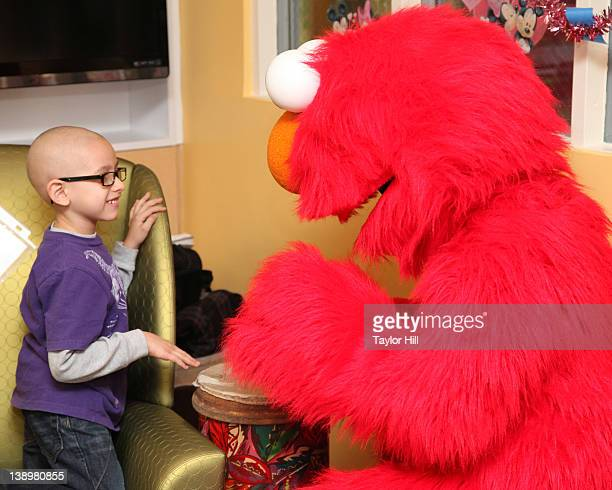 Christian plays the bongos with Elmo as they deliver Valentines to children at the NYU Rusk Institute of Rehabilitation Medicine at NYU Langone Med...