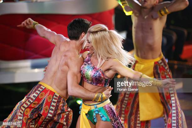 Christian Polanc and Kathrin Menzinger perform on stage during the 9th show of the tenth season of the television competition 'Let's Dance' on May 19...
