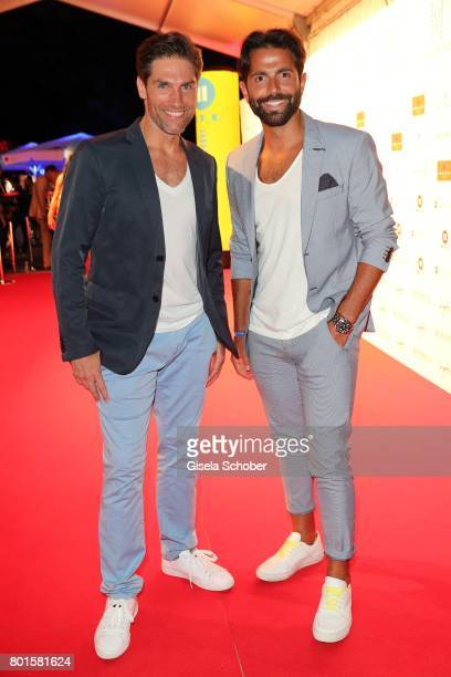 MUNICH GERMANY JUNE 26 Christian Polanc and Serhat Yilmaz during the Movie meets Media Party during the Munich Film Festival on June 26 2017 in...