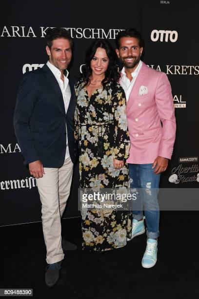 Christian Polanc Serhat Yilmaz and Christina Luft attend the Guido Maria Kretschmer Fashion Show Autumn/Winter 2017 at Tempodrom on July 5 2017 in...