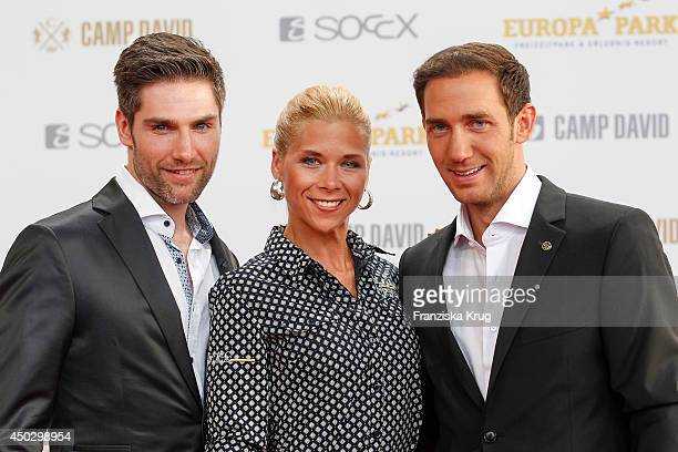 Christian Polanc Tanja Schewtschenko and Marcel Remus attend the 'Fashion World Camp David und Soccx' Store Opening on June 08 2014 in Rust Germany