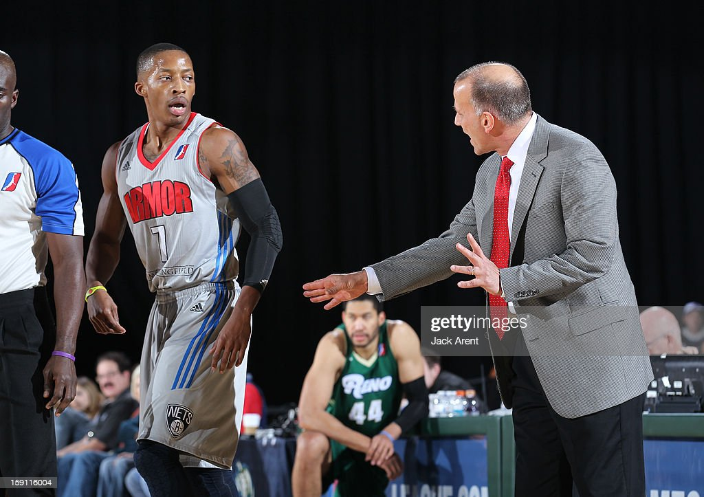 Christian Polk #7 of the Springfield Armor takes direction from head coach Robert MacKinnon while playing against the Reno Bighorns during the 2013 NBA D-League Showcase on January 7, 2013 at the Reno Events Center in Reno, Nevada.