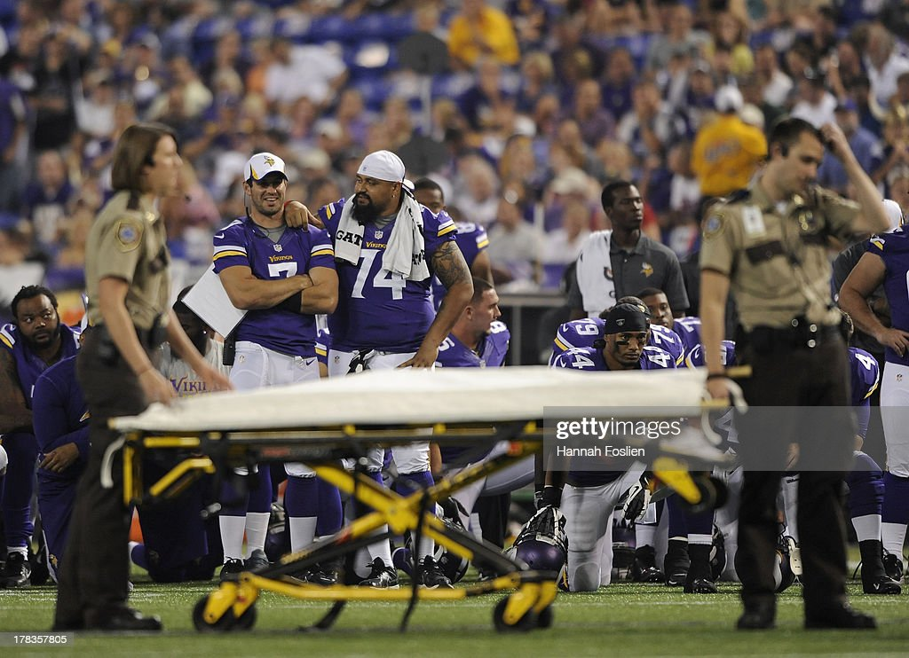 <a gi-track='captionPersonalityLinkClicked' href=/galleries/search?phrase=Christian+Ponder&family=editorial&specificpeople=4505733 ng-click='$event.stopPropagation()'>Christian Ponder</a> #7 and Charlie Johnson #74 of the Minnesota Vikings look on as paramedics look at teammate Seth Olsen #72 during the second quarter of the game against the Tennessee Titans on August 29, 2013 at Mall of America Field at the Hubert H. Humphrey Metrodome in Minneapolis, Minnesota.