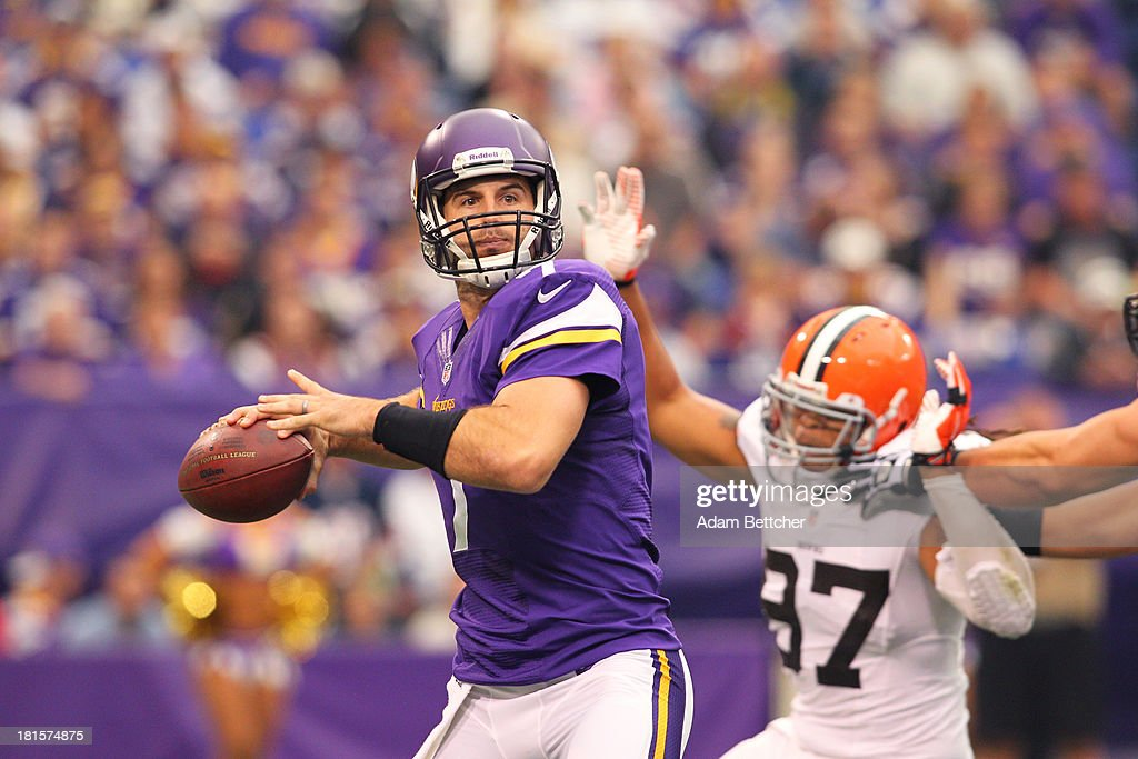 <a gi-track='captionPersonalityLinkClicked' href=/galleries/search?phrase=Christian+Ponder&family=editorial&specificpeople=4505733 ng-click='$event.stopPropagation()'>Christian Ponder</a> #7 of the Minnesota Vikings advances the ball against the Cleveland Browns on September 22, 2013 at Mall of America Field at the Hubert Humphrey Metrodome in Minneapolis, Minnesota.