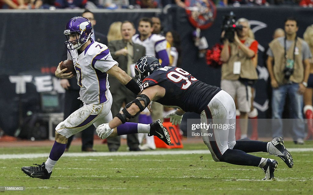 <a gi-track='captionPersonalityLinkClicked' href=/galleries/search?phrase=Christian+Ponder&family=editorial&specificpeople=4505733 ng-click='$event.stopPropagation()'>Christian Ponder</a> #7 of the Minnesota Vikings avoids a tackle by <a gi-track='captionPersonalityLinkClicked' href=/galleries/search?phrase=J.J.+Watt&family=editorial&specificpeople=6243554 ng-click='$event.stopPropagation()'>J.J. Watt</a> #99 of the Houston Texans at Reliant Stadium on December 23, 2012 in Houston, Texas. Minnesota Vikings defeat the Houston Texans 23-6.