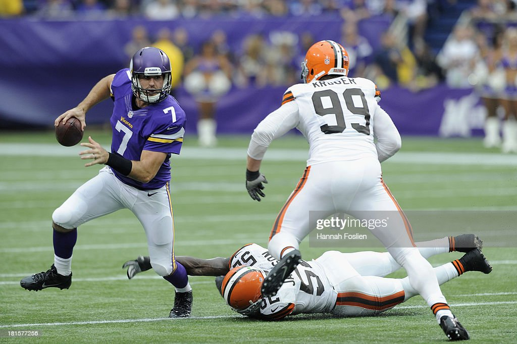 <a gi-track='captionPersonalityLinkClicked' href=/galleries/search?phrase=Christian+Ponder&family=editorial&specificpeople=4505733 ng-click='$event.stopPropagation()'>Christian Ponder</a> #7 of the Minnesota Vikings avoids tackles by <a gi-track='captionPersonalityLinkClicked' href=/galleries/search?phrase=D%27Qwell+Jackson&family=editorial&specificpeople=648560 ng-click='$event.stopPropagation()'>D'Qwell Jackson</a> #52 and Paul Kruger #99 of the Cleveland Browns during the fourth quarter of the game on September 22, 2013 at Mall of America Field at the Hubert H. Humphrey Metrodome in Minneapolis, Minnesota. The Browns defeated the Vikings 31-27.