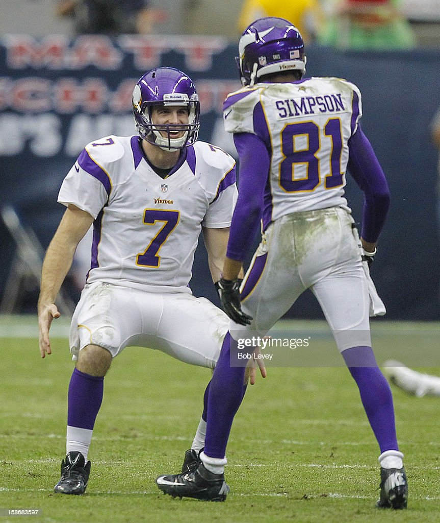 <a gi-track='captionPersonalityLinkClicked' href=/galleries/search?phrase=Christian+Ponder&family=editorial&specificpeople=4505733 ng-click='$event.stopPropagation()'>Christian Ponder</a> #7 of the Minnesota Vikings congratulates Jerome Simpson #81 of the Minnesota Vikings after making a big catch along the sideline against the Houston Texans at Reliant Stadium on December 23, 2012 in Houston, Texas. Minnesota Vikings defeat the Houston Texans 23-6.