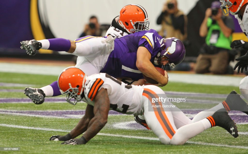 <a gi-track='captionPersonalityLinkClicked' href=/galleries/search?phrase=Christian+Ponder&family=editorial&specificpeople=4505733 ng-click='$event.stopPropagation()'>Christian Ponder</a> #7 of the Minnesota Vikings dives into the end zone for a touchdown against the Cleveland Browns on September 22, 2013 at Mall of America Field at the Hubert Humphrey Metrodome in Minneapolis, Minnesota.