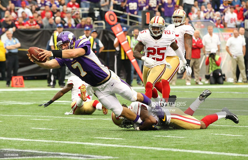 <a gi-track='captionPersonalityLinkClicked' href=/galleries/search?phrase=Christian+Ponder&family=editorial&specificpeople=4505733 ng-click='$event.stopPropagation()'>Christian Ponder</a> #7 of the Minnesota Vikings dives into the end zone during the second quarter while <a gi-track='captionPersonalityLinkClicked' href=/galleries/search?phrase=Ahmad+Brooks&family=editorial&specificpeople=2326499 ng-click='$event.stopPropagation()'>Ahmad Brooks</a> #55 of the San Francisco 49ers attempts the tackle at the Hubert H. Humphrey Metrodome on September 23, 2012 in Minneapolis, Minnesota.