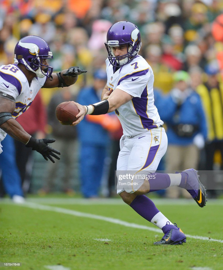 Christian Ponder #7 of the Minnesota Vikings hands off to teammate Adrian Peterson #28 during an NFL game against the Green Bay Packers at Lambeau Field on December 2, 2012 in Green Bay, Wisconsin.