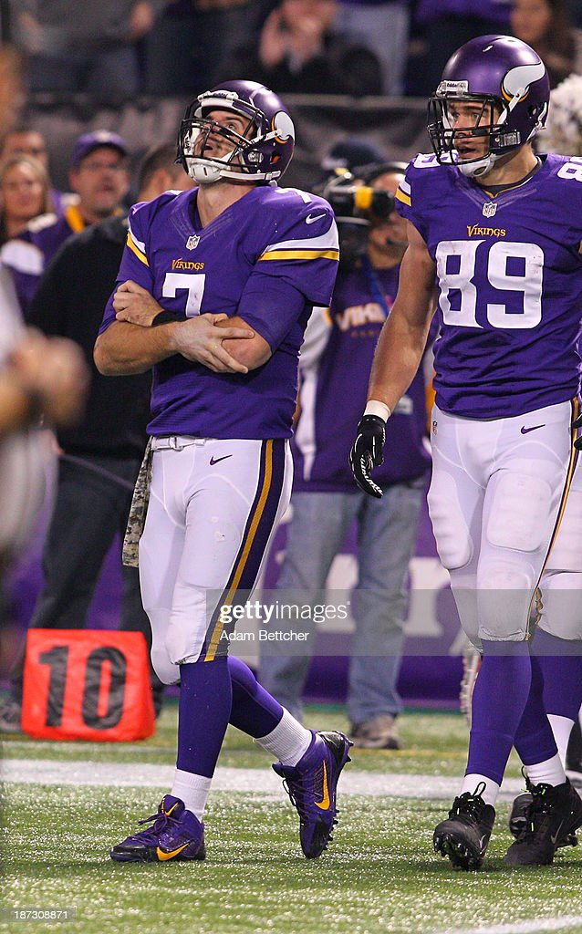 <a gi-track='captionPersonalityLinkClicked' href=/galleries/search?phrase=Christian+Ponder&family=editorial&specificpeople=4505733 ng-click='$event.stopPropagation()'>Christian Ponder</a> #7 of the Minnesota Vikings holds his elbow after taking a hard fall while John Carlson #89 of the Minnesota Vikings watches for a trainer while playing against the Washington Redskins on November 7, 2013 at Mall of America Field at the Hubert Humphrey Metrodome in Minneapolis, Minnesota.