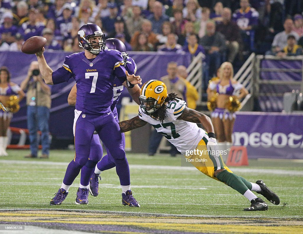 Christian Ponder #7 of the Minnesota Vikings passes during an NFL game against the Green Bay Packers at Mall of America Field at the Hubert H. Humphrey Metrodome on October 27, 2013 in Minneapolis, Minnesota.