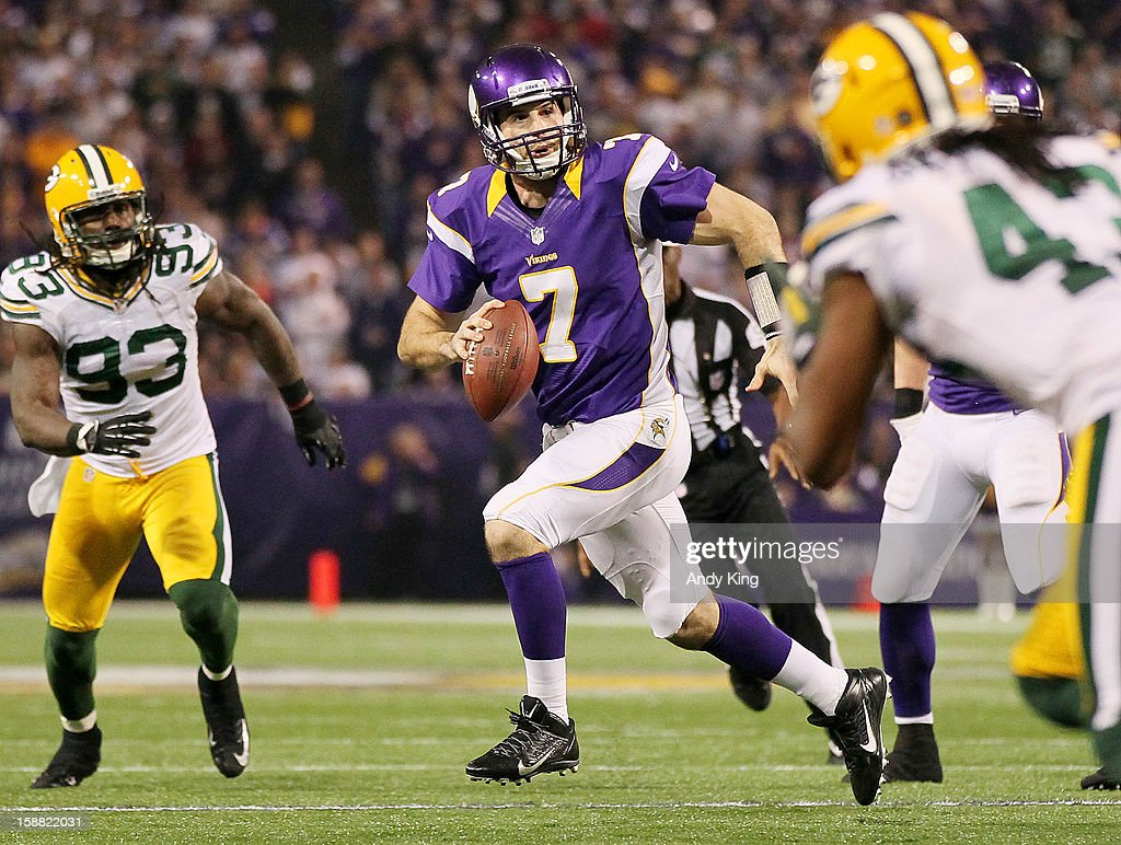 Christian Ponder #7 of the Minnesota Vikings runs from Green Bay Packers defenders during the third quarter on December 30, 2012 at Mall of America Field at the Hubert H. Humphrey Metrodome in Minneapolis, Minnesota. The Vikings defeated the Packers 37-34.