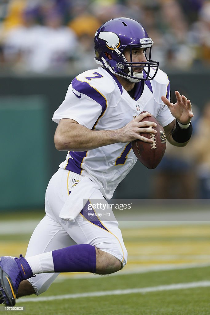 <a gi-track='captionPersonalityLinkClicked' href=/galleries/search?phrase=Christian+Ponder&family=editorial&specificpeople=4505733 ng-click='$event.stopPropagation()'>Christian Ponder</a> #7 of the Minnesota Vikings runs the ball against the Green Bay Packers at Lambeau Field on December 2, 2012 in Green Bay, Wisconsin. The Packers defeated the Vikings 23-14.