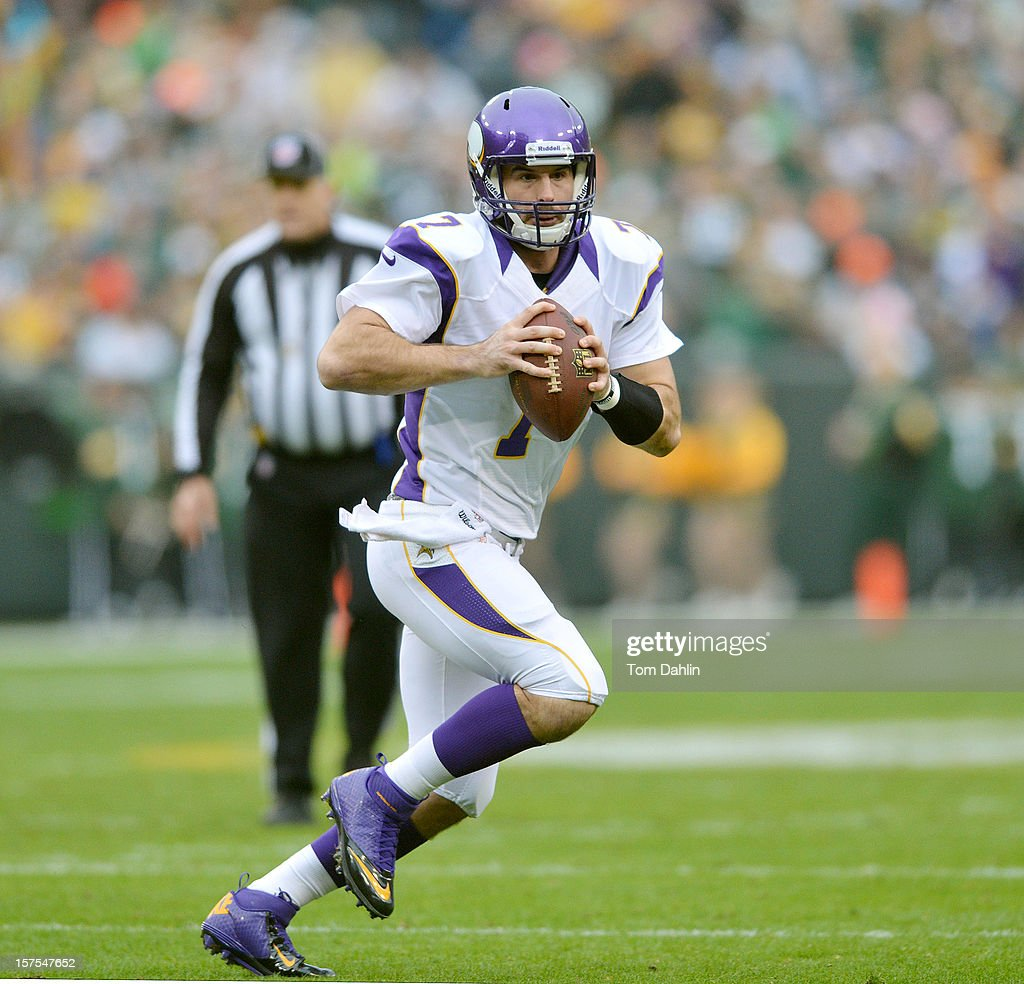 Christian Ponder #7 of the Minnesota Vikings scrambles during an NFL game against the Green Bay Packers at Lambeau Field on December 2, 2012 in Green Bay, Wisconsin.