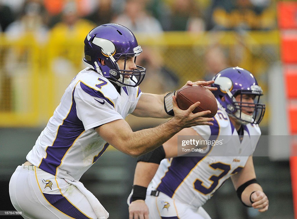 Christian Ponder #7 of the Minnesota Vikings takes the snap during an NFL game against the Green Bay Packers at Lambeau Field on December 2, 2012 in Green Bay, Wisconsin.