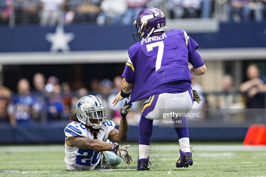 <a gi-track='captionPersonalityLinkClicked' href=/galleries/search?phrase=Christian+Ponder&family=editorial&specificpeople=4505733 ng-click='$event.stopPropagation()'>Christian Ponder</a> #7 of the Minnesota Vikings tries to avoid the tackle of <a gi-track='captionPersonalityLinkClicked' href=/galleries/search?phrase=B.W.+Webb&family=editorial&specificpeople=7308996 ng-click='$event.stopPropagation()'>B.W. Webb</a> #20 of the Dallas Cowboys at AT&T Stadium on November 3, 2013 in Arlington, Texas. The Cowboys defeated the Vikings 27-23.