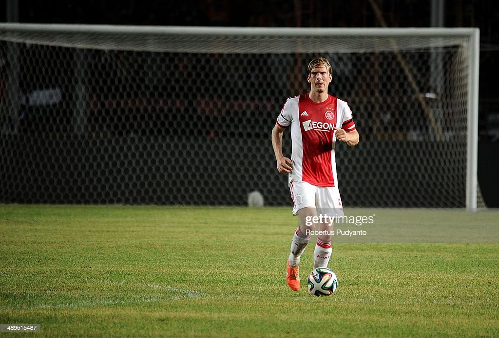 <a gi-track='captionPersonalityLinkClicked' href=/galleries/search?phrase=Christian+Poulsen&family=editorial&specificpeople=228068 ng-click='$event.stopPropagation()'>Christian Poulsen</a> of AFC Ajax runs with the ball during the international friendly match between Perija Jakarta and AFC Ajax on May 11, 2014 in Jakarta, Indonesia. AFC Ajax win the game with score 3-0.