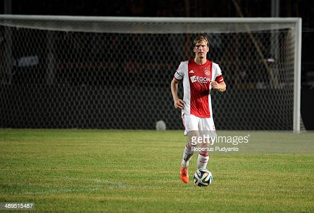 Christian Poulsen of AFC Ajax runs with the ball during the international friendly match between Perija Jakarta and AFC Ajax on May 11 2014 in...