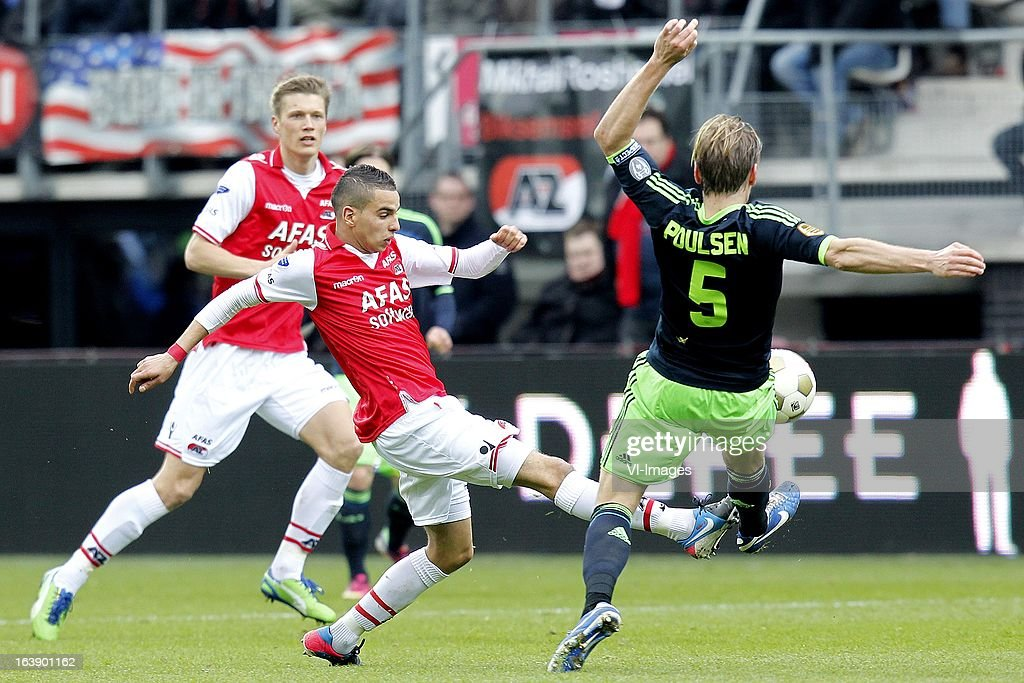 Christian Poulsen of Ajax (R), Adam Maher of AZ (L) during the Dutch Eredivisie match between AZ Alkmaar and Ajax Amsterdam at the AFAS Stadium on march 17, 2013 in Alkmaar, The Netherlands
