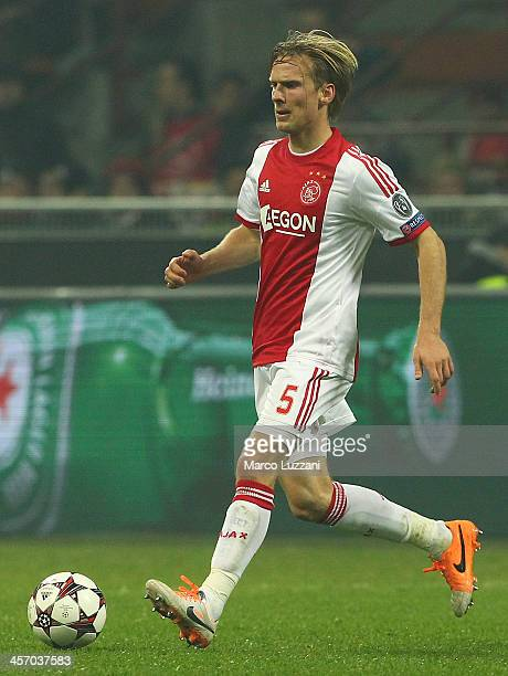 Christian Poulsen of Ajax Amsterdam in action during the UEFA Champions League Group H match between AC Milan and Ajax Amsterdam at Stadio Giuseppe...