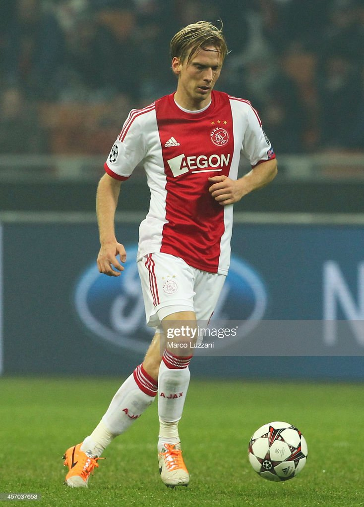 <a gi-track='captionPersonalityLinkClicked' href=/galleries/search?phrase=Christian+Poulsen&family=editorial&specificpeople=228068 ng-click='$event.stopPropagation()'>Christian Poulsen</a> of Ajax Amsterdam in action during the UEFA Champions League Group H match between AC Milan and Ajax Amsterdam at Stadio Giuseppe Meazza on December 11, 2013 in Milan, Italy.