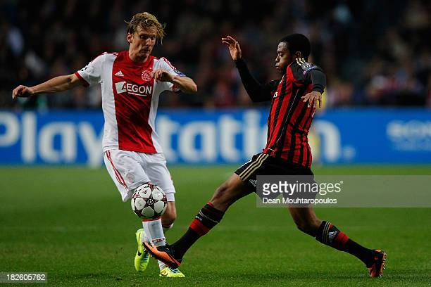 Christian Poulsen of Ajax and Robinho of AC Milan battle for the ball during the UEFA Champions League Group H match between Ajax Amsterdam and AC...
