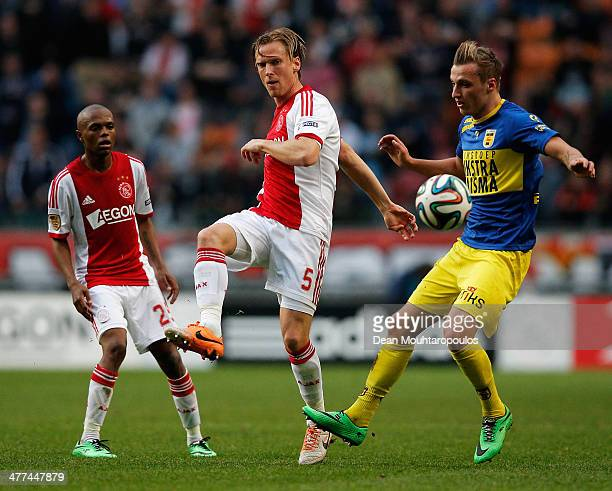 Christian Poulsen of Ajax clears the ball away from Marcel Ritzmaier of Cambuur during the Eredivisie match between Ajax Amsterdam and SC Cambuur...