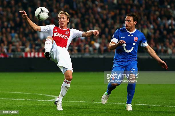 Christian Poulsen of Ajax clears the ball away from Robbert Schilder of Twente during the Eredivisie match between Ajax Amsterdam and FC Twente at...