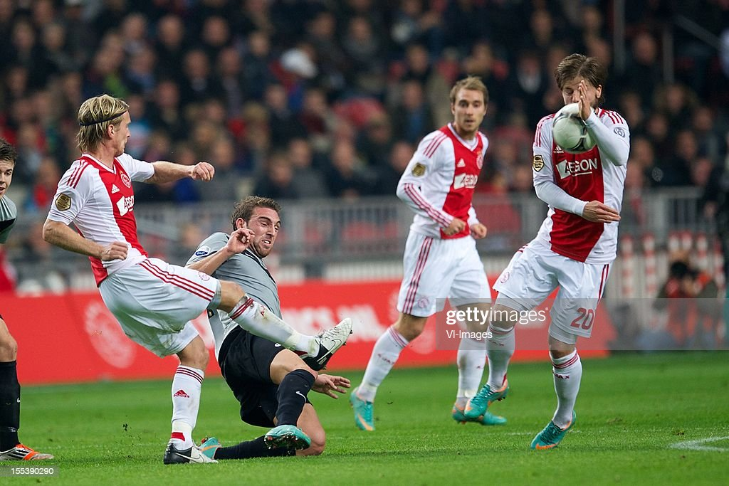 Christian Poulsen of Ajax, Guram Kashia of Vitesse, Lasse Schone of Ajax during the Dutch Eredivisie match between Ajax Amsterdam and Vitesse Arnhem at the Amsterdam Arena on November 3, 2012 in Amsterdam, The Netherlands.