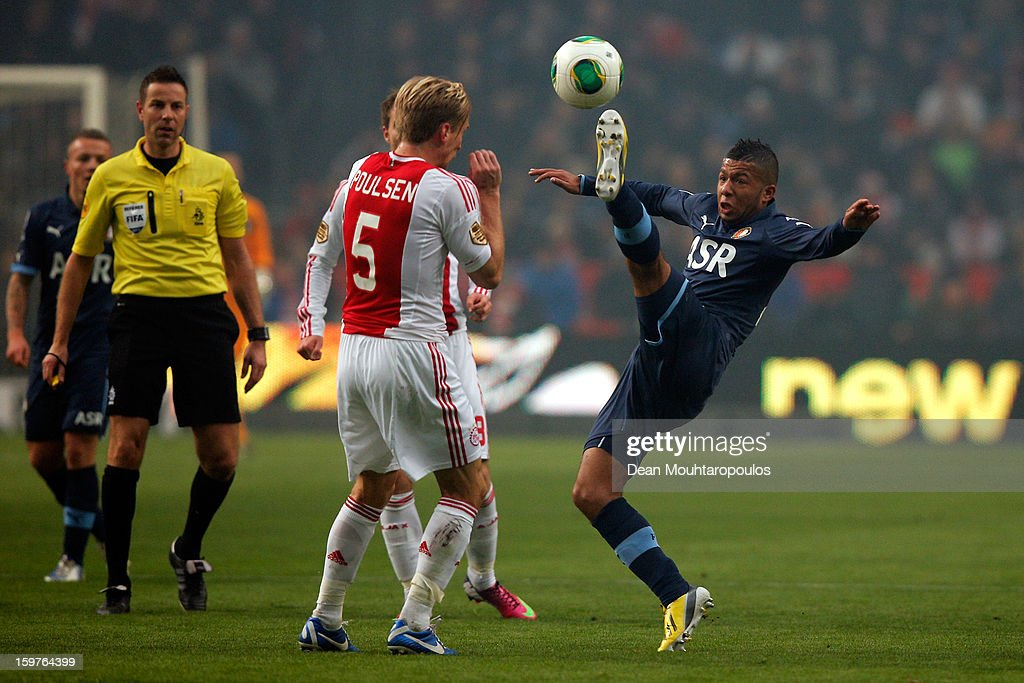 Christian Poulsen (#5) of Ajax hides his face from the high foot from Tonny Vilhena of Feyenoord during the Eredivisie match between Ajax Amsterdam and Feyenoord Rotterdam at Amsterdam Arena on January 20, 2013 in Amsterdam, Netherlands.