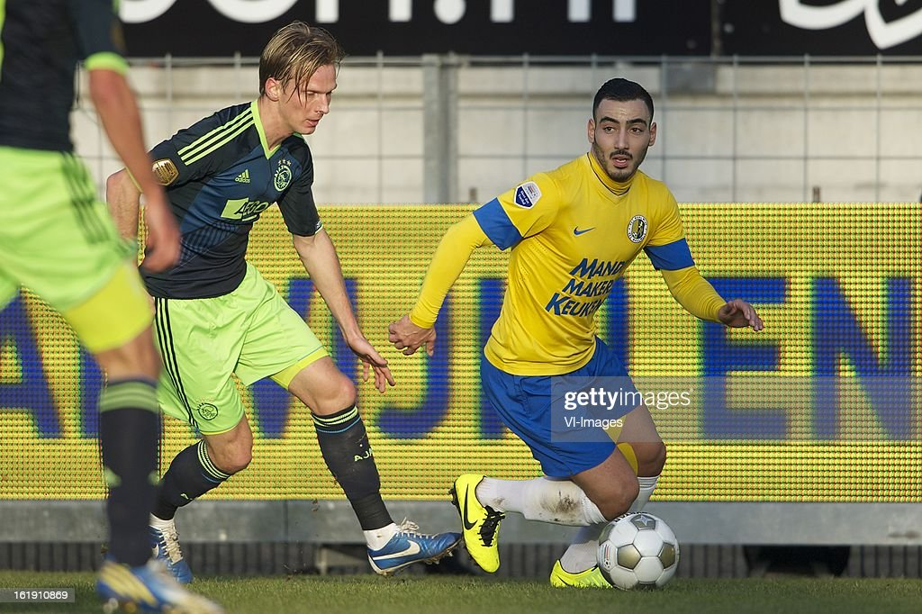 Christian Poulsen of Ajax, Imad Najah of RKC Waalwijk during the Dutch Eredivisie match between RKC Waalwijk and Ajax Amsterdam at the Mandemakers Stadium on february 17, 2013 in Waalwijk, The Netherlands