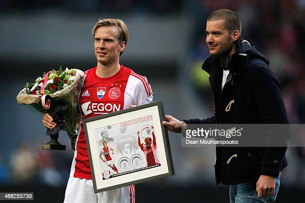 Christian Poulsen of Ajax is presented with some gifts after the Eredivisie match between Ajax Amsterdam and NEC Nijmegen in which this is his last...
