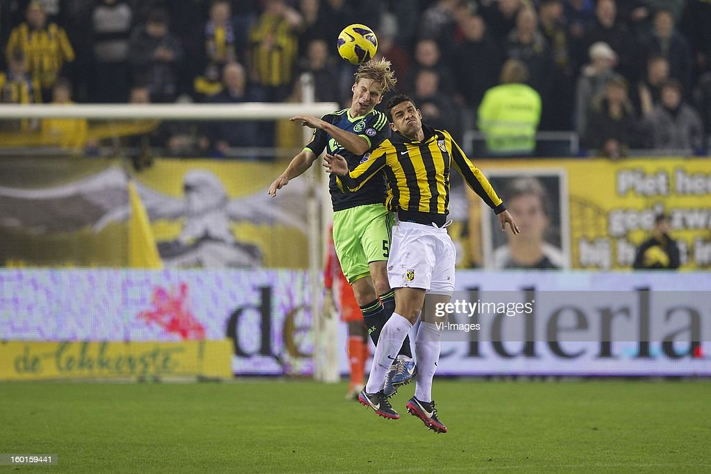 Christian Poulsen of Ajax, Jonathan Reis of Vitesse during the Dutch Eredivise match between Vitesse Arnhem and Ajax Amsterdam at the Gelredome on January 27, 2013 in Arnhem, The Netherlands.