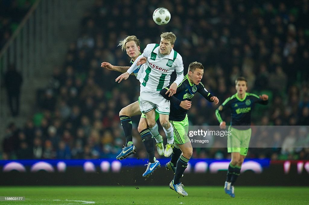 Christian Poulsen of Ajax, Michael de Leeuw of FC Groningen, Niklas Moisander of Ajax during the Dutch Cup match between FC Groningen and Ajax Amsterdam at the Euroborg on December 20, 2012 in Groningen, The Netherlands.